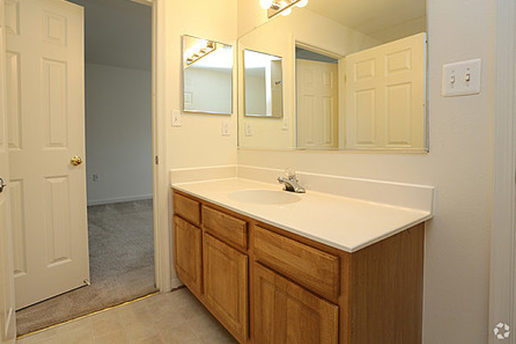 Wide bathroom vanity with sick, cabinets, mirror and medicine cabinet